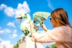 Woman with Dragon statue in Ljubljana city Royalty Free Stock Image