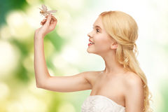 Woman with dragonfly in hand Stock Photography