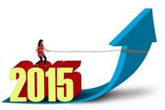 Woman drags upward arrow Stock Images