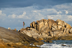 Woman in dramatic landscape Stock Images