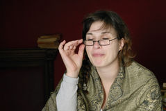 Woman drapped in shawl wit glasses on her nose Royalty Free Stock Image