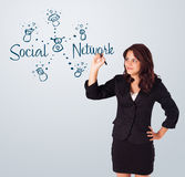 Woman draving social network theme on whiteboard Stock Image