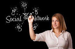 Woman draving social network theme on whiteboard. Young woman draving social network theme on whiteboard Royalty Free Stock Photography