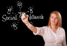 Woman draving social network theme on whiteboard Stock Photos