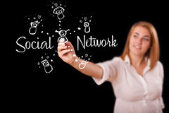 Woman draving social network theme on whiteboard. Young woman draving social network theme on whiteboard Royalty Free Stock Images