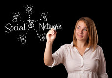 Woman draving social network theme on whiteboard Royalty Free Stock Photos