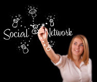 Woman draving social network theme on whiteboard Royalty Free Stock Images