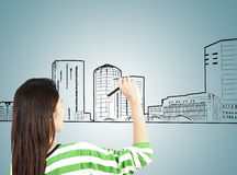 Woman draw building and cityscape Royalty Free Stock Photo