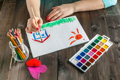 Woman draw house and sun. Loan concept royalty free stock photos