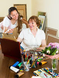 Woman draw a picture for her admirer Royalty Free Stock Image