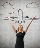 Woman and drawing airliner Royalty Free Stock Images
