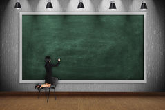 Woman drawing on blank blackboard Royalty Free Stock Photos