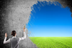 Woman drawing a  blue sky Stock Image