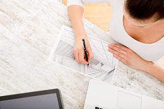 Woman drawing a blueprint Stock Photography