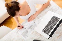 Woman drawing a blueprint Royalty Free Stock Photos