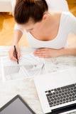 Woman drawing a blueprint Royalty Free Stock Photo