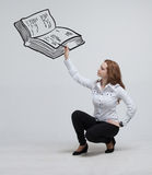 Woman drawing a book Royalty Free Stock Image