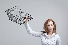Woman drawing a book Royalty Free Stock Images