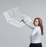 Woman drawing a book Royalty Free Stock Photos