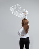 Woman drawing a book Stock Photography