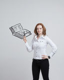 Woman drawing a book Stock Photo