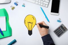 Woman drawing bulb on white background Royalty Free Stock Photography