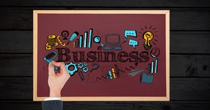 Woman drawing business icons on board Royalty Free Stock Photos