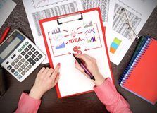 Woman drawing business plan Royalty Free Stock Photography