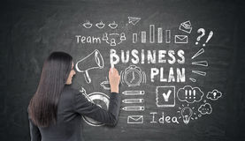 Woman drawing a business plan sketch Royalty Free Stock Photos