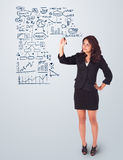 Woman drawing business scheme and icons on whiteboard. Young woman drawing business scheme and icons on whiteboard Stock Image