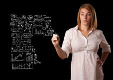 Woman drawing business scheme and icons on whiteboard Stock Photo