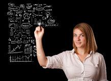 Woman drawing business scheme and icons Royalty Free Stock Photo