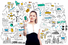 Woman drawing business sketch. Attractive young woman on white background drawing creative business sketch. Success concept stock image