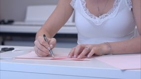 Woman drawing butterfly with paper template. Close up shot. Professional shot on BMCC RAW with high dynamic range. You can use it e.g. in your commercial video royalty free stock image