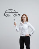 Woman drawing car, concept on the subject of Stock Images