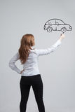 Woman drawing car, concept on the subject of Stock Photography