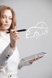 Woman drawing car, concept on the subject of Royalty Free Stock Photography