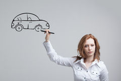 Woman drawing car, concept on the subject of Stock Image