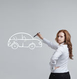 Woman drawing car, concept on the subject of Royalty Free Stock Photo