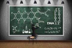 Woman drawing chemical scheme Royalty Free Stock Image