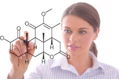 Woman drawing a chemistry pattern stock photos