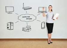 Woman drawing computer network Stock Images