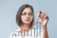 Woman drawing diagram Stock Photo