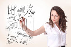 Woman drawing diagrams on whiteboard Royalty Free Stock Images