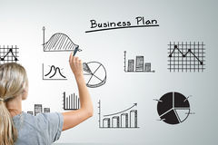 Woman drawing different business plan graphs royalty free stock photography