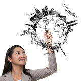 Woman drawing the dream travel. Around the world in a whiteboard Royalty Free Stock Photography