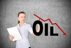 Woman drawing  falling oil Royalty Free Stock Photos