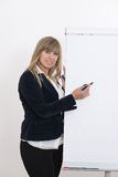 Woman is drawing on a flip chart Stock Photos