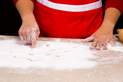 Woman drawing into flour Royalty Free Stock Photos