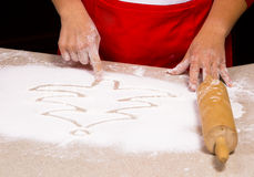 Woman drawing into flour Royalty Free Stock Photo